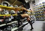 sexy girl en string pose dans le rayon casque d'un magasin moto à Nantes 44